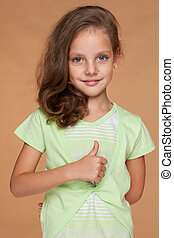 Little girl with her thumb up