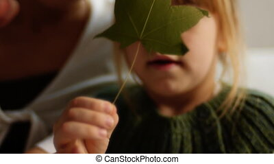 little girl with herbarium