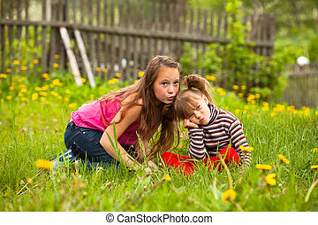 Little girl with his sister in the park.
