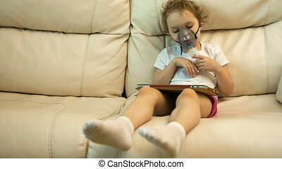 little girl with inhaler on sofa