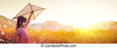 Little Girl With Kite In The Field At Sunset