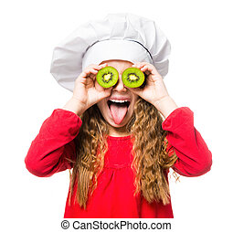 little girl in chef hat with dvemya rugs kiwi on eyes shows tongue on white background