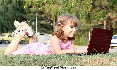 little girl with laptop
