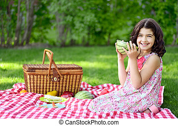 little girl with large watermelon