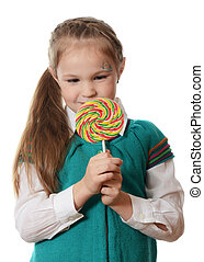Little girl with lollipop isolated on white background