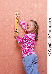 Little girl with measurement level