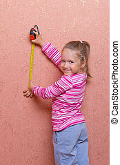 Little girl with measurement tape