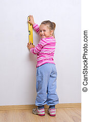 Little girl with measuring level