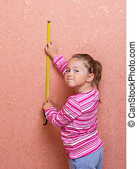 Little girl with measuring tape