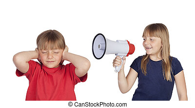 Little girl with megaphone shouting to her twin sister