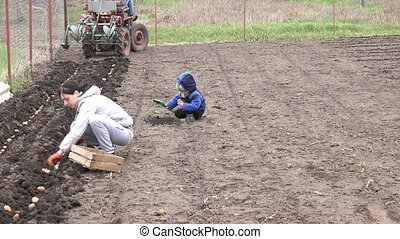Little Girl with Mother Seed Potato