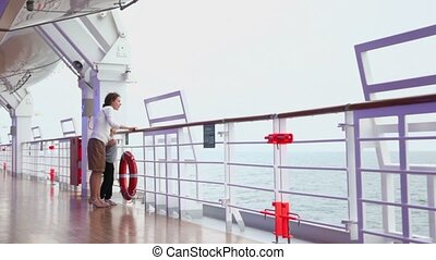 Little girl with mother walk by deck near fence during cruise