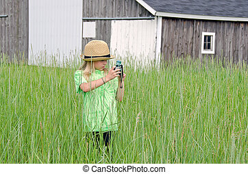 little girl with old camera