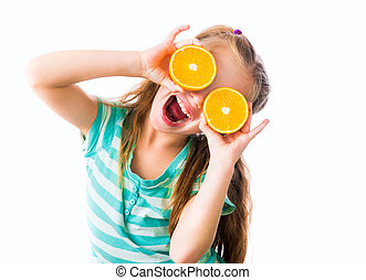 funny little girl with two halves of oranges isolated on white background