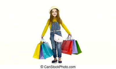 Little girl with packages in hands whirl around him. White background