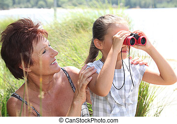 Little girl with pair of binoculars