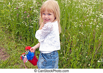 little girl with patriotic pail