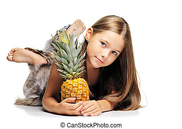 Little girl with pineapple