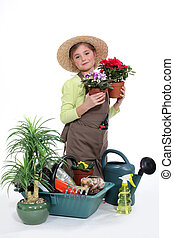 Little girl with plants