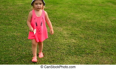 Little girl with plumeria flower