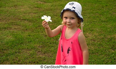 Little girl with plumeria flower