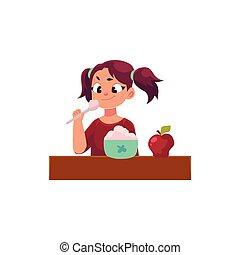 Little girl with ponytails having breakfast