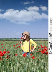 little girl with poppy flower spring season