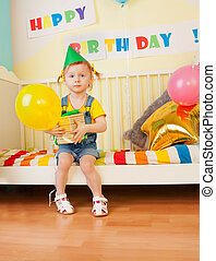 Little girl with present and baloon