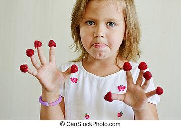 girl with raspberry