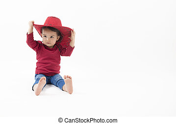 little girl with red cowboy hat isolated on white