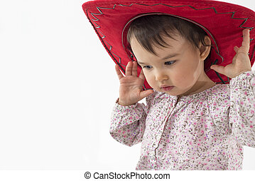 little girl with red cowboy hat