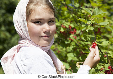 Little girl with red currant
