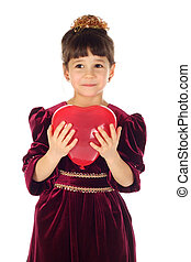 Little girl with red heart-like balloon