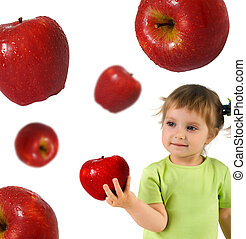 Little girl with ripe apple