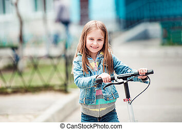 Little girl with scooter