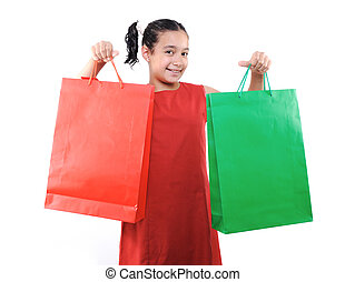 Little girl with shopping bags and boxes, isolated