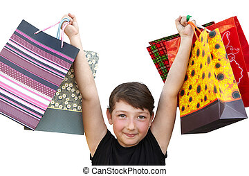 Little girl with shopping bags on white background