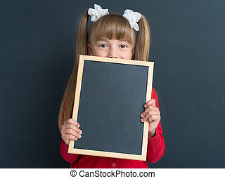 Little girl with small blackboard