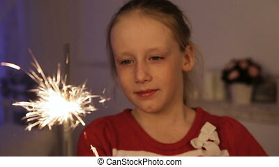 Little girl with sparklers.