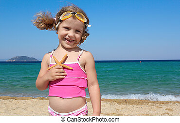 little girl with strafish posing
