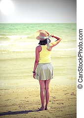 little girl with straw hat also called boater in summer
