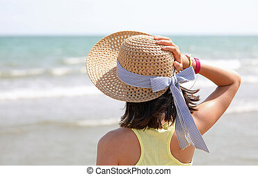 Little girl with straw hat called boater