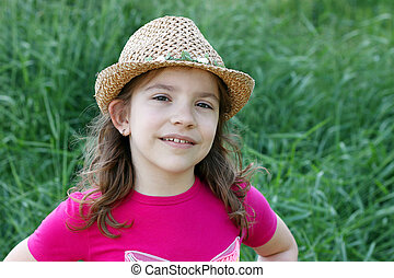 Little girl with straw hat portrait