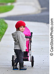 Little girl with stroller
