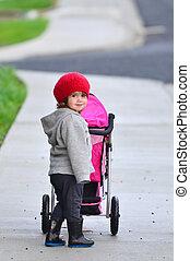 Little girl with stroller