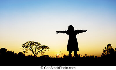 Little girl with sunset