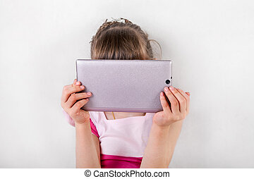 Little Girl with Tablet - Small Girl behind the Tablet...