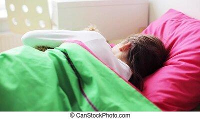 little girl with teddy bear sleeping at home