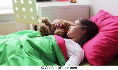 little girl with teddy bear sleeping at home - children,...