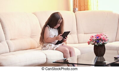 little girl with the tablet